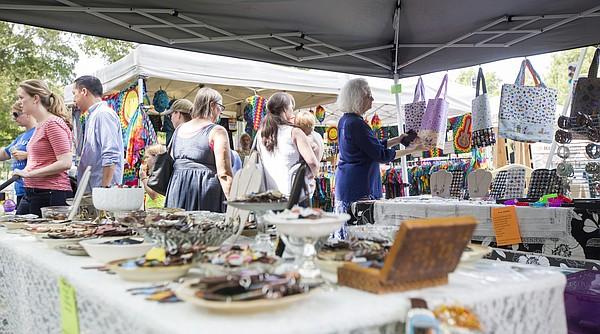 Shoppers browse through booths at the 2015 Fall Arts and Crafts Festival on Sunday in South Park in downtown Lawrence. The festival featured music, food, giant bubbles, mini horse rides and, of course, plenty of arts and crafts for everyone.