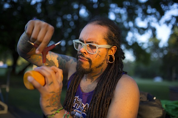 Scary Larry founder Malakai Edison uses a tool to tighten the head of his mallet before a game on Thursday, Aug. 20, 2015.