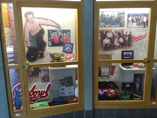 A case featuring Jaybowl memorabilia, outside the entrance to the Jay in the Kansas Union.