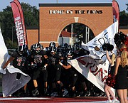 The Lions break out in style for the start of the season opener as Lawrence went against Blue Valley West Friday.