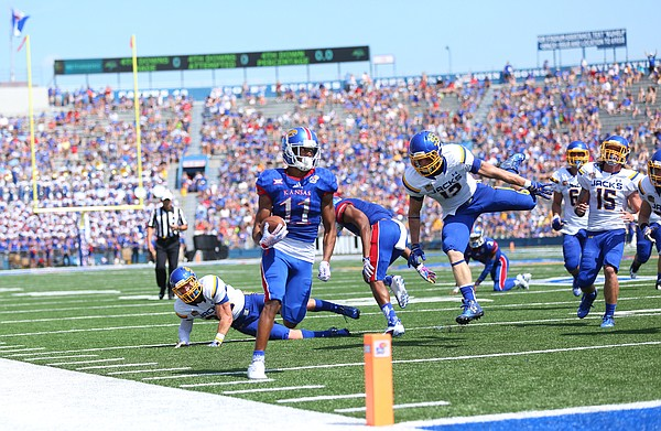 Kansas wide receiver Tre' Parmalee (11) eyes the end zone as he heads in for a touchdown during the second quarter on Saturday, Sept. 5, 2015 at Memorial Stadium.