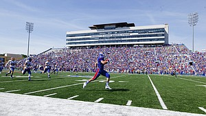 Kansas kick returner Ryan Schadler (33) runs back a 91-yard touchdown after a kickoff during the first quarter on Saturday, Sept. 5, 2015 at Memorial Stadium.