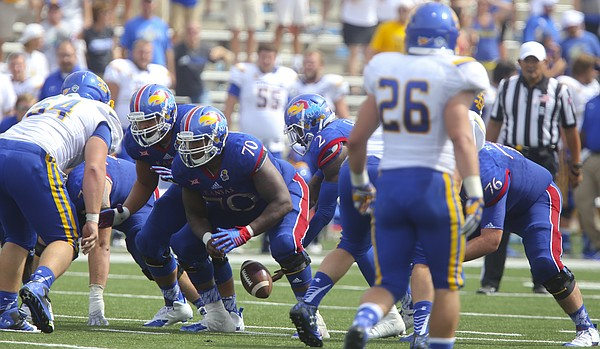 Kansas quarterback Montell Cozart (2) fumbles a snap behind Kansas offensive lineman Keyon Haughton (70) with seven seconds remaining in the game against South Dakota State on Saturday, Sept. 5, 2015 at Memorial Stadium. The error cost the Jayhawks an attempt at a game-tying field goal.