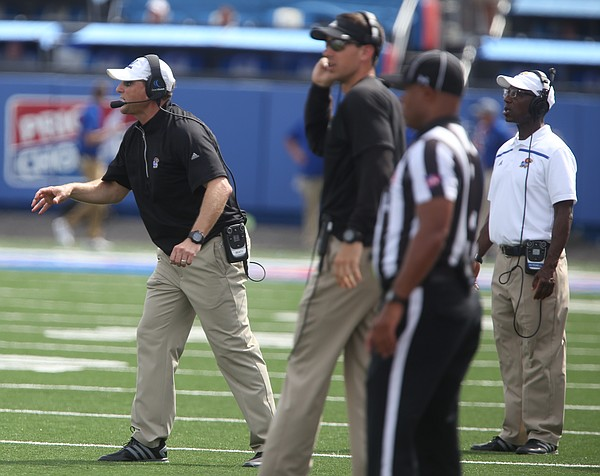 Kansas head coach David Beaty, left, calls for the ball to be spiked following Cozart's fumble as time runs out on Saturday, Sept. 5, 2015 at Memorial Stadium.