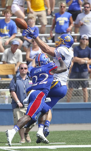 South Dakota State tight end Dallas Goedert (86) pulls in a deep pass over Kansas safety Greg Allen (22) to put the Jackrabbits within scoring position late in the fourth quarter on Saturday, Sept. 5, 2015 at Memorial Stadium.