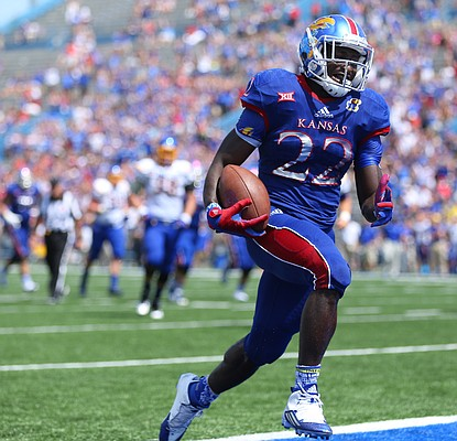 Kansas running back Ke'aun Kinner (22) makes his way in for a touchdown during the third quarter on Saturday, Sept. 5, 2015 at Memorial Stadium.