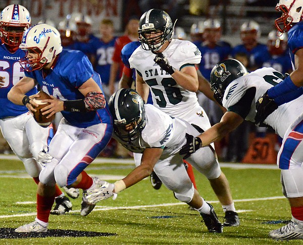 The Firdbirds' defense wraps up the Eagles quarterback in the first half of Free State's 24-20 loss against Olathe North Friday at ODAC.