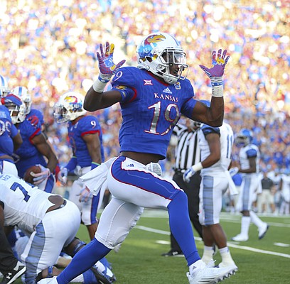 Kansas cornerback Tyrone Miller Jr. (19) celebrates a Jayhawk recovery of a Memphis fumble during the first quarter on Saturday, Sept. 12, 2015 at Memorial Stadium.