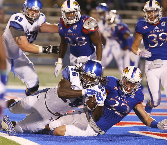Memphis running back Jarvis Cooper (25) overpowers Kansas linebacker Schyler Miles (32) as he fall into the end zone for a touchdown during the third quarter on Saturday, Sept. 12, 2015 at Memorial Stadium.