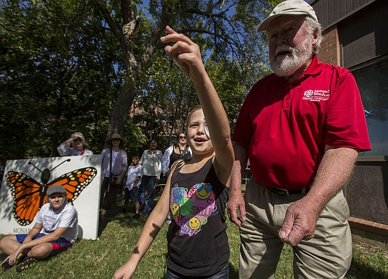 Monarch Watch director Chip Taylor gets a little help from Haylee Diers, 7, of Baldwin City, in releasing a tagged monarch butterfly  during the Monarch Watch open house Saturday morning at Foley Hall, 2021 Constant Ave., on Kansas University's west campus. On Saturday, Sept. 19, 2015, Monarch Watch will be hosting a monarch tagging event from 7:30 a.m. until 11:30 a.m. below the southeast corner of the Clinton Lake dam. The public is invited to attend and help tag butterflies.