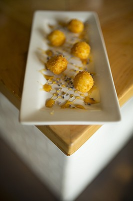 Goat cheese croquettes with wildflower honey and lavender at Ingredient, 947 Massachusetts.