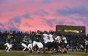 The Lawrence High Lions and Free State Firebirds collide as the sun goes down during the first half on Friday, Sept. 17, 2015 at Free State High School.