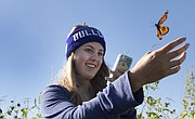 Mia Talley, 15, of Baldwin, releases a monarch butterfly after tagging it Saturday, Sept. 19, 2015, during Monarch Watch's monarch tagging event on the site of a wetland restoration project on the east side of Clinton Lake.