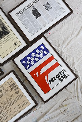 "A political art poster inspired by Thompson's wish to rename Aspen, Colorado, ""Fat City, U.S.A.,"" is positioned on the floor of the gallery as other pieces in the show are prepared to be hung on Monday, Sept. 21, 2015 at the Lawrence Arts Center."