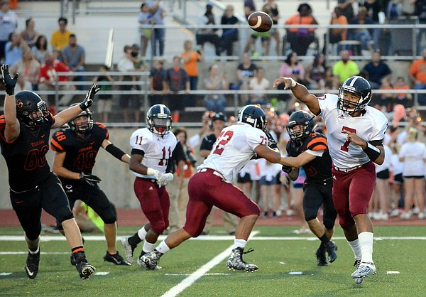LHS quarterback Alan Clothier gets a quick pass to the air early in the first half in the Lions' 41-6 victory over SM Northwest on Thursday, Sept. 24, 2015, in Overland Park.