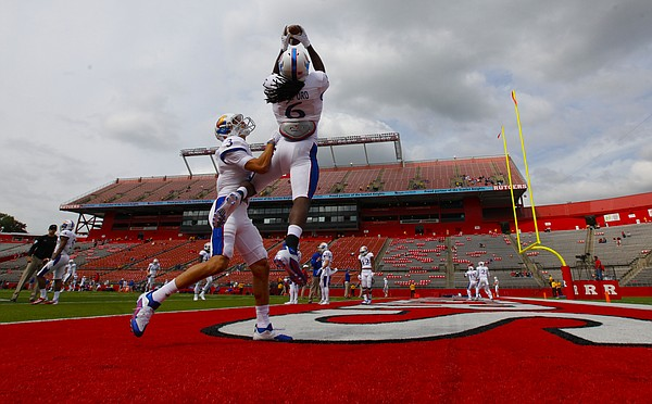 Kansas receiver Joshua Stanford (6) pulls in an end zone pass over teammate Kansas wide receiver Chase Harrell (3) during warmups prior to kickoff against Rutgers on Saturday, Sept. 26, 2015 at High Point Solutions Stadium in Piscataway, New Jersey.