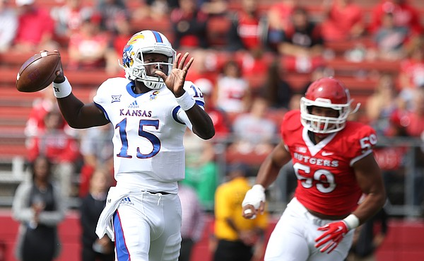 Kansas quarterback Deondre Ford (15) is chased by Rutgers linebacker Darnell Davis Jr. (59) during the first quarter on Saturday, Sept. 26, 2015 at High Point Solutions Stadium in Piscataway, New Jersey. Ford was the starting quarterback for the Jayhawks.