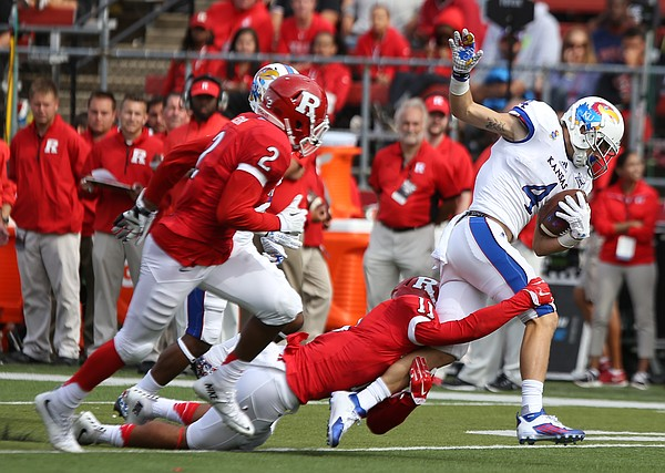 Kansas wide receiver Tyler Patrick (4) is dragged down by Rutgers defensive back Isaiah Wharton (11) after a long gain during the fourth quarter on Saturday, Sept. 26, 2015 at High Point Solutions Stadium in Piscataway, New Jersey.
