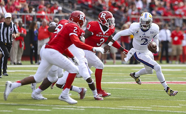 Kansas quarterback Montell Cozart (2) has nowhere to go as he is surrounded by Rutgers defensive back Kiy Hester (2) and linebacker Steve Longa (3) during the third quarter on Saturday, Sept. 26, 2015 at High Point Solutions Stadium in Piscataway, New Jersey.