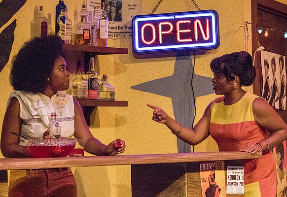"Brianna Woods, left, and Ayzia Underwood run through a scene during a dress rehearsal Tuesday, Sept. 29, 2015 at Murphy Hall for the upcoming production of ""Detroit '67"" by KU Theatre."