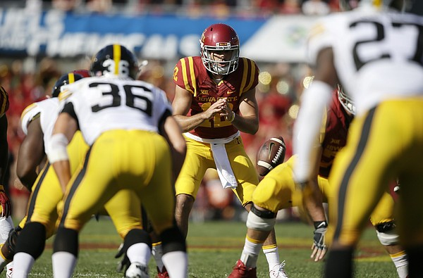 Iowa State quarterback Sam B. Richardson takes a snap during the first half of an NCAA college football game against Iowa, Saturday, Sept. 12, 2015, in Ames, Iowa. (AP Photo/Charlie Neibergall)