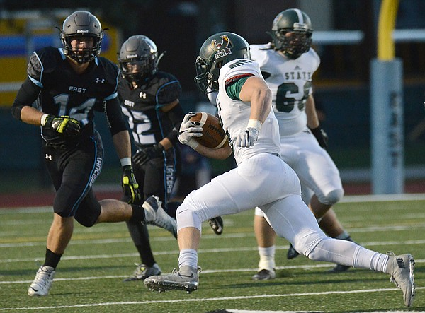 Sam Skwarlo goes wide outside for yards in the first half as Free State played Shawnee Mission East Friday in Overland Park. The Firebirds won, 32-20.