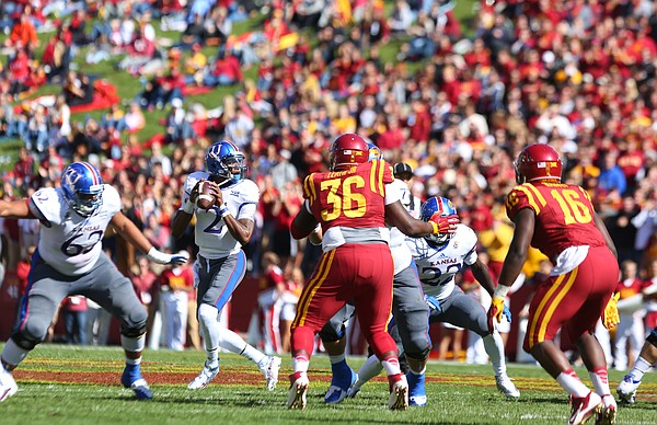 Kansas quarterback Montell Cozart (2) drops back to pass during the second quarter on Saturday, Oct. 3, 2015 at Jack Trice Stadium in Ames, Iowa.