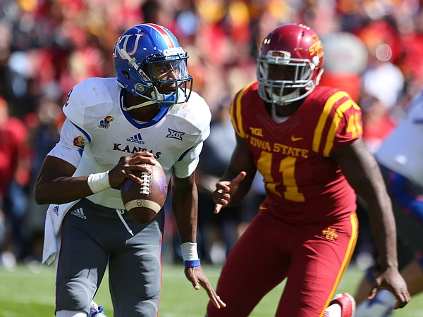 Kansas quarterback Montell Cozart (2) tries to escape the oncoming rush of Iowa State defensive end Gabe Luna (11) during the third quarter on Saturday, Oct. 3, 2015 at Jack Trice Stadium in Ames, Iowa.