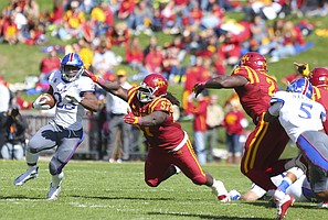 Kansas running back De'Andre Mann (23) is chased by Iowa State defensive lineman Demond Tucker (97) during the third quarter on Saturday, Oct. 3, 2015 at Jack Trice Stadium in Ames, Iowa.