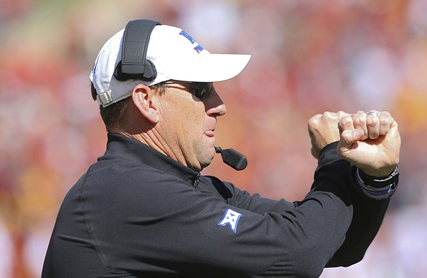 Kansas head coach David Beaty gives a signal to his players during the fourth quarter on Saturday, Oct. 3, 2015 at Jack Trice Stadium in Ames, Iowa.