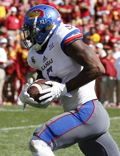 Kansas linebacker Marcquis Roberts (5) runs back an interception for a touchdown during the fourth quarter on Saturday, Oct. 3, 2015 at Jack Trice Stadium in Ames, Iowa.
