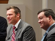"Kansas Secretary of State Kris Kobach, left, and Kansas University law professor Stephen McAllister respond to questions from an audience on the KU campus during a symposium on voting laws entitled ""Protecting the Vote."""