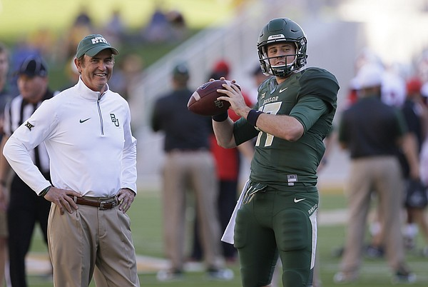 Baylor quarterback Seth Russell (17) warms up as coach Art Briles watches before an NCAA college football game against Lamar, Saturday, Sept. 12, 2015, in Waco, Texas. (AP Photo/LM Otero)