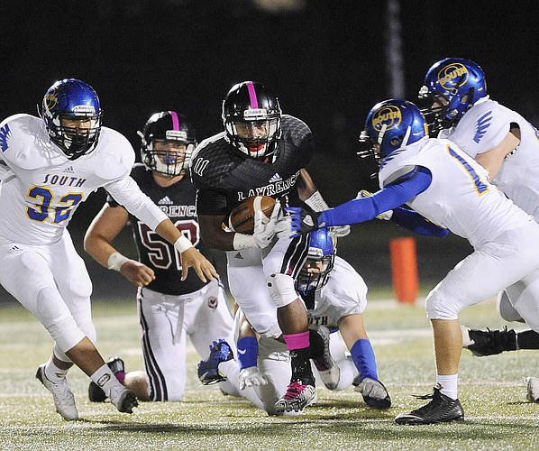 LHS senior JD Woods (11) looks for running room in a 63-7 victory over Olathe South on Friday, Oct. 9, 2015, at LHS.
