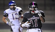 Lawrence High's JD Woods goes 25 yards for his fifth TD of the night in a 63-7 victory over Olathe South on Friday, Oct. 9, 2015, at LHS.