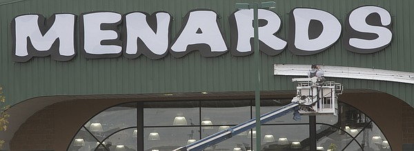 A workman finishes up some trim work Friday, Oct. 9, 2015, on the front of Menards, 1352 N. 1300 Rd.