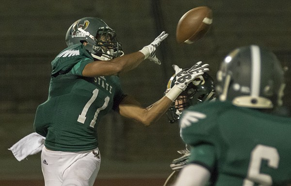 Free State junior receiver Zack Sanders (11) pulls down a reception in traffic during the Firebirds' game against Shawnee Mission South Friday evening at FSHS.