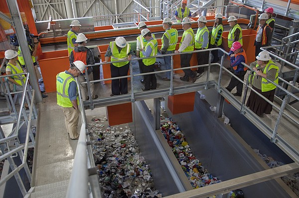 Lawrence city commissioners and city management personnel tour the Hamm Material Recovery Facility in October 2014. The plant receives, sorts and processes the city's recyclable materials, including glass.