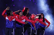 Members of the Kansas women's basketball team dance during Late Night in the Phog, Friday, Oct. 9, 2015 at Allen Fieldhouse.