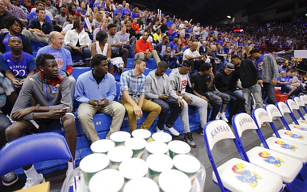 A long row of Kansas recruits sit to watch the Late Night in the Phog festivities, Friday, Oct. 9, 2015 at Allen Fieldhouse.