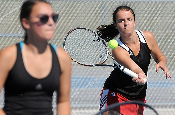 Natalie Cote advances to the ball during doubles Regional tennis action Saturday in Gardner.