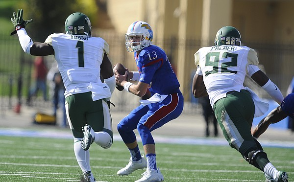 Kansas quarterback Ryan Willis (13) is chased down by Baylor linebacker Taylor Young (1) and defensive end Jamal Palmer (92) during the first quarter on Saturday, Oct. 10, 2015 at Memorial Stadium.
