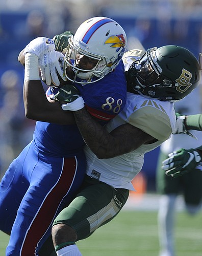 Kansas receiver Jeremiah Booker (88) pulls in a catch as he is brought down by Baylor cornerback Xavien Howard during the first quarter on Saturday, Oct. 10, 2015 at Memorial Stadium.
