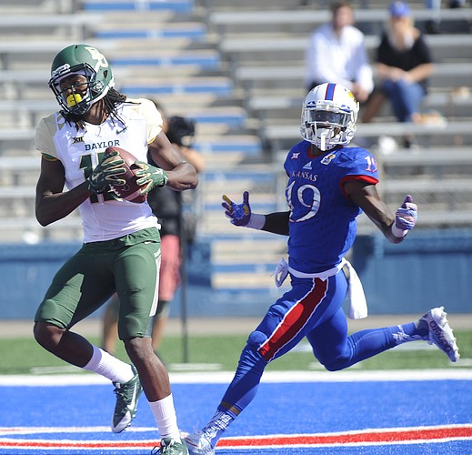 Baylor wide receiver Davion Hall (16) brings in a touchdown catch as Kansas cornerback Tyrone Miller Jr. (19) reacts with disbelief during the third quarter on Saturday, Oct. 10, 2015 at Memorial Stadium.