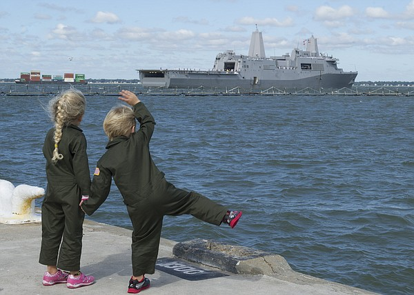 NORFOLK (Oct. 6, 2015) Children wave goodbye to their father, Lt. Chris Robinson, deploying aboard the amphibious transport dock USS Arlington (LPD 24). Arlington deployed as part of the Kearsarge Amphibious Ready Group in support of maritime security operations and theater security cooperation efforts in the U.S. 5th and 6th Fleet areas of responsibility. (U.S. Navy photo by Mass Communication Specialist Seaman Amy M. Ressler/Released)