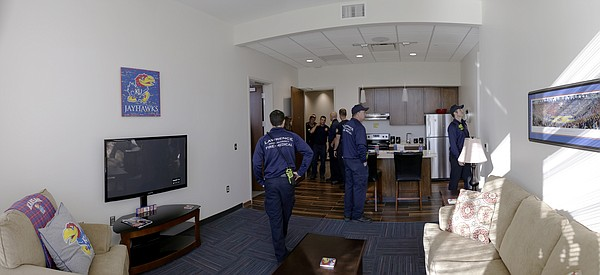 Members of the Lawrence-Douglas County Fire Medical department tour a living unit at the new $11.2 million McCarthy Hall, which houses the Kansas men's basketball team.