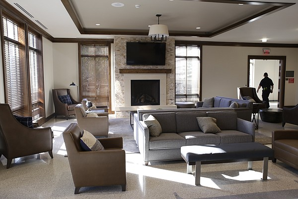 A fireplace, television and seating fill the lobby of KU's new $11.2 million McCarthy Hall, which houses the Kansas men's basketball team.