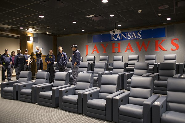 Lawrence-Douglas County Fire and Medical personnel tour the media room inside the new $11.2 million McCarthy Hall, which houses the Kansas men's basketball team.