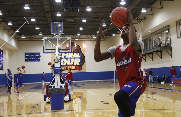 KU freshman Lagerald Vick works on layups early during practice on Thursday, Oct. 15, 2015.