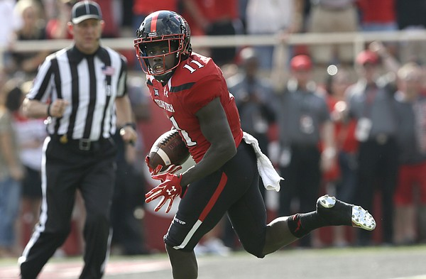 In this Sept. 26, 2015, file photo, Texas Tech wide receiver Jakeem Grant (11) runs in for a touchdown after a reception in the first half of an NCAA college football game against TCU in Lubbock, Texas. Baylor, West Virginia, Texas Tech and TCU all have a 100-yard rusher and a 100-yard receiver. The rest of the power-five conferences have only one such team, plus Notre Dame.(AP Photo/LM Otero, File)